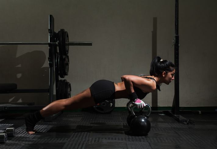 woman-gym-training-kettlebells